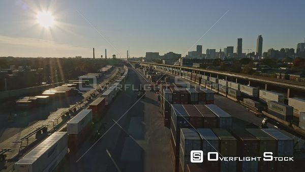 Atlanta Flying low over industrial train car container yard looking into sunset