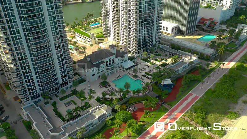 Aerial pull out reveal Blue and Green Diamond Miami Beach a luxury condominium pool deck