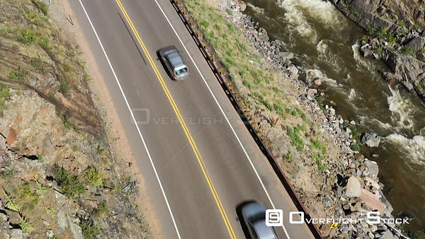 Mountain highway with traffic along a mountain stream in a canyon, Loveland, Colorado, USA