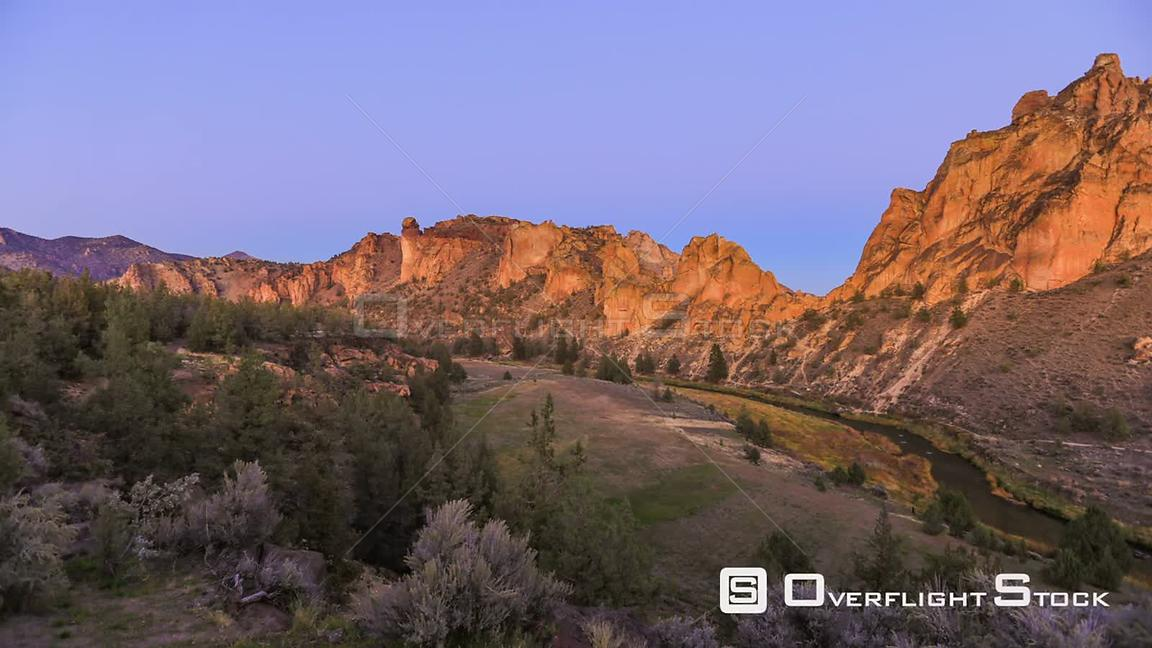 Oregon USA Smith Rocks panning time lapse during sunset into night.