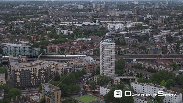 Commuter Train in London Low Rise Apartment Suburbs England Drone Video