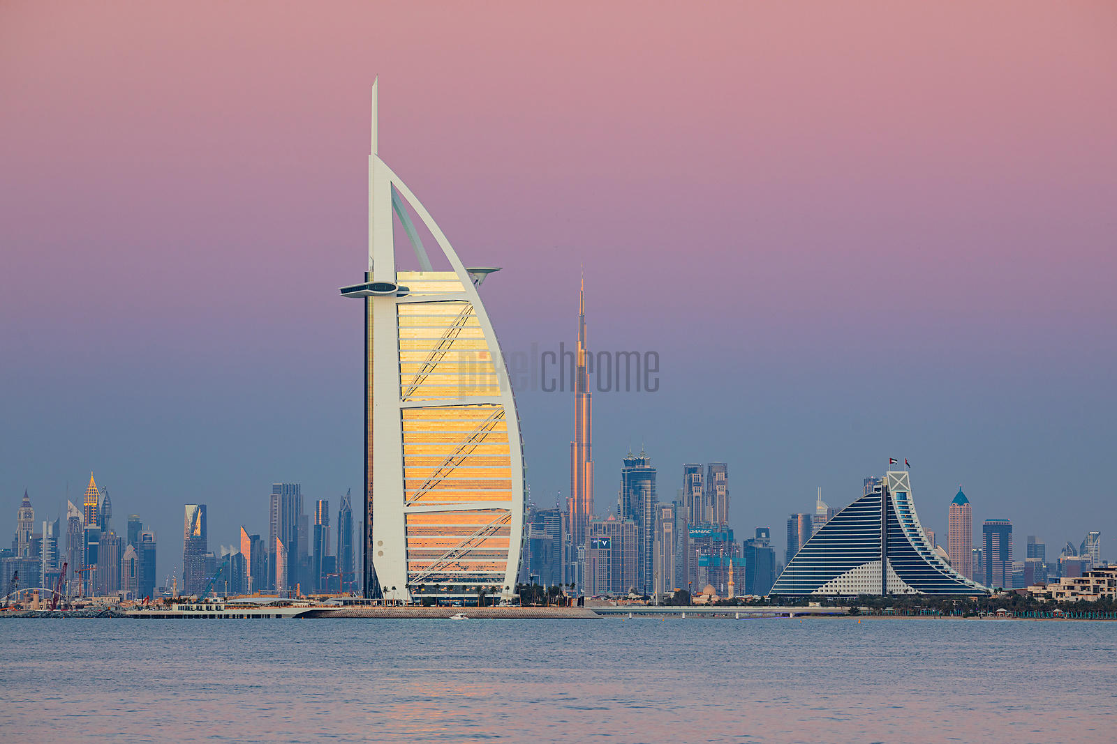 Distant View of the Burj al Arab and the Skyline of Dubai at Dusk