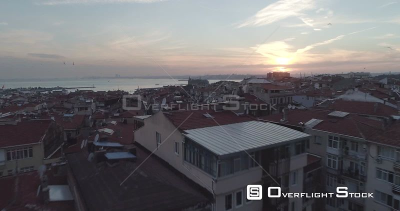 Low Aerial View Above Rooftops of Istanbul Asian Side Towards Haydarpasa Railway Station Turkey