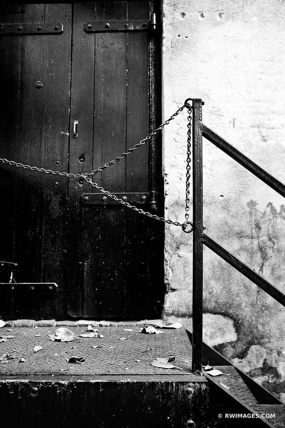 OLD DOOR HISTORIC CHARLESTON SOUTH CAROLINA BLACK AND WHITE VERTICAL