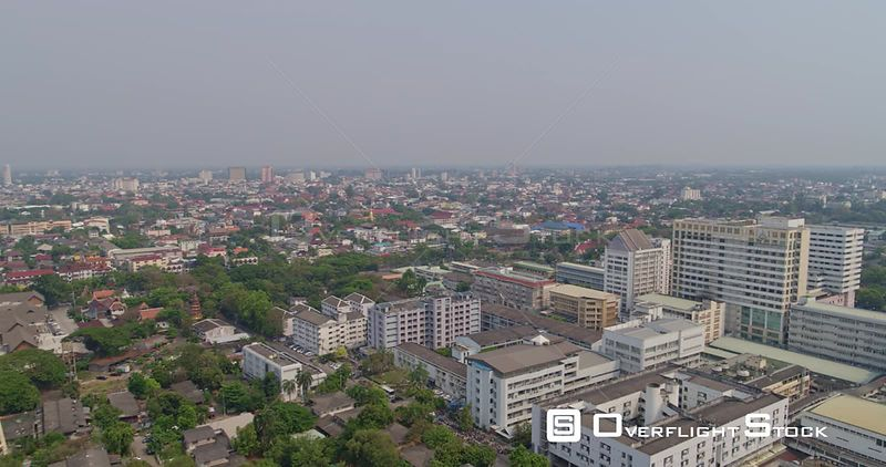 Chang Mai Thailand Aerial Flying around, looking out over cityscape to low birdseye view
