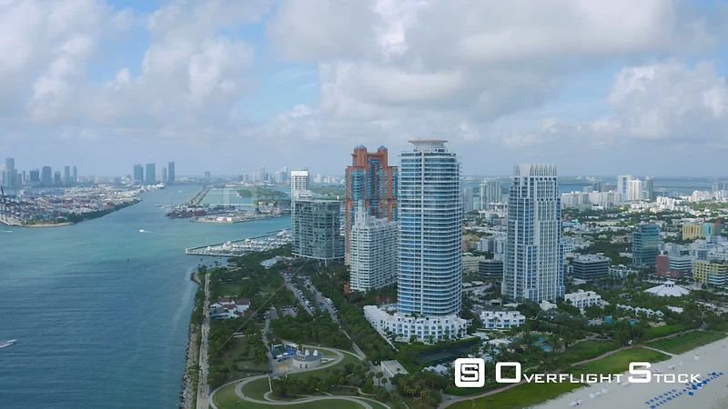 Miami Florida Flying over main channel panning with cityscape and South Beach views.
