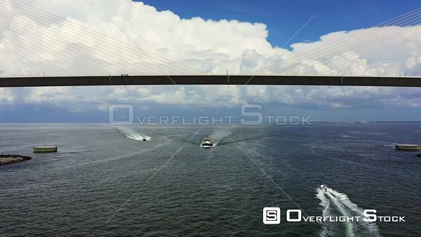 Aerial video boats passing under the Sunshine Skyway Bridge