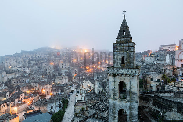 View of Matera with the Tower of the Church of San Pietro Barisano in the Foreground at Dawn