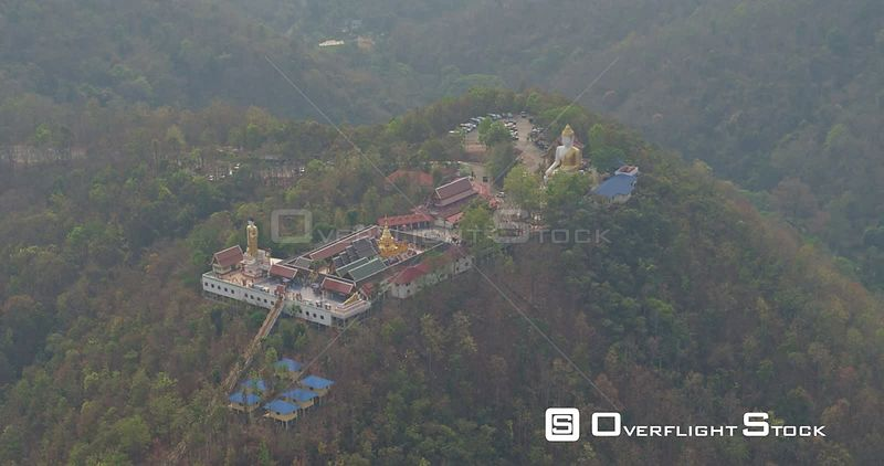 Chang Mai Thailand Aerial Panning birdseye view of temple with people