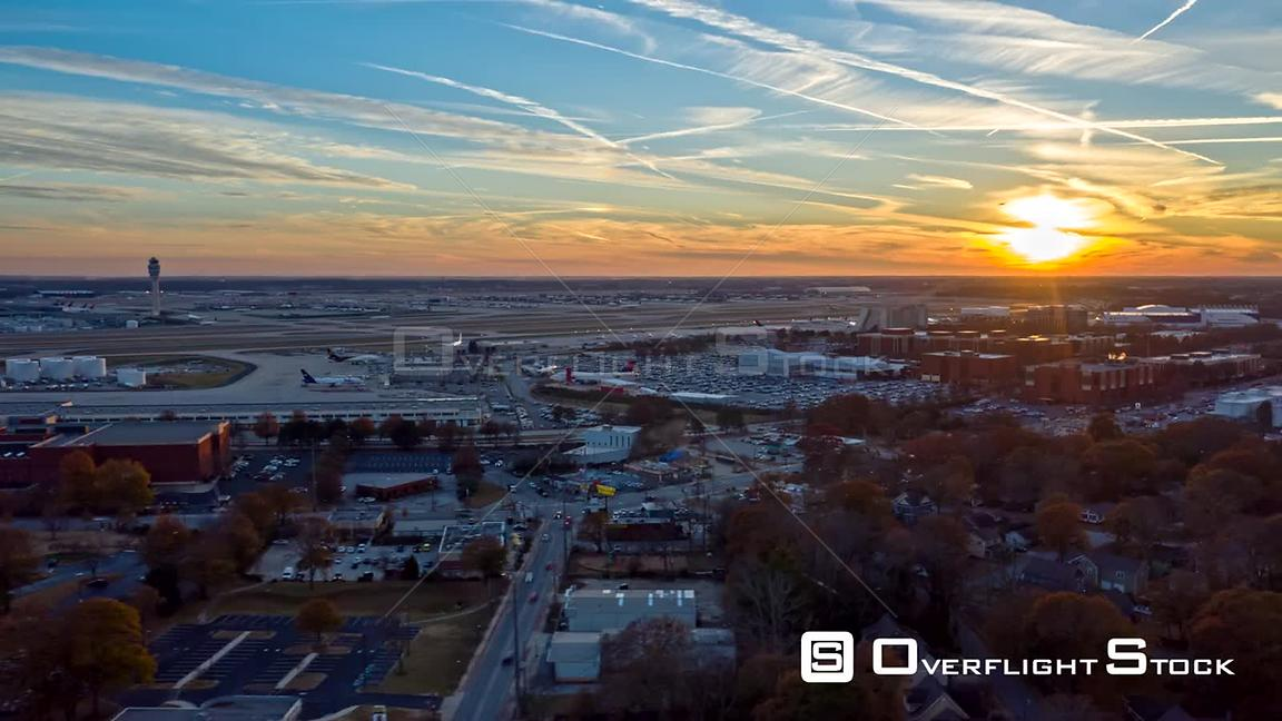 Atlanta Aerial Hyperlapse flying, following path of airport runway with planes at sunset, dusk