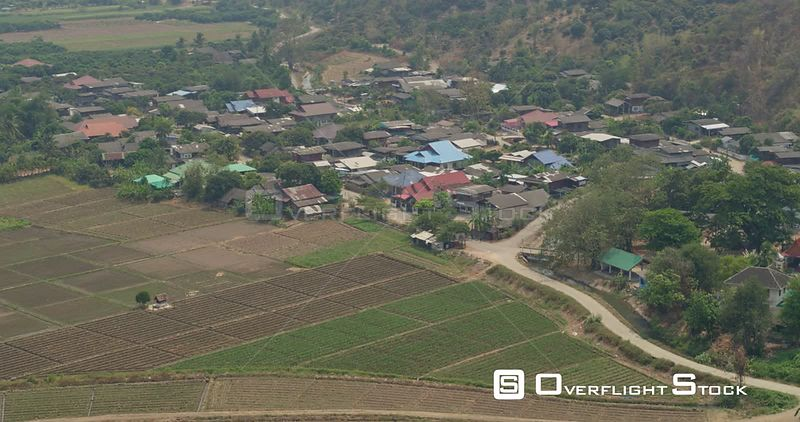 Thung Pi Thailand Aerial Panning birdseye to panoramic view of village, farmland, and hills