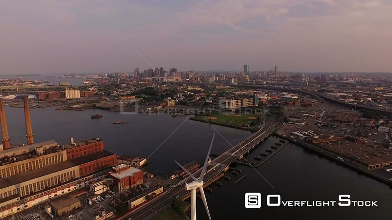 Large wind turbine and industrial area towards downtown. Boston Massachusetts