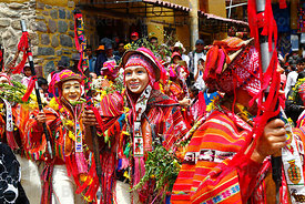 Masked dancers wearing traditional dress of the region at Bajada de Reyes festival, Ollantaytambo, Peru