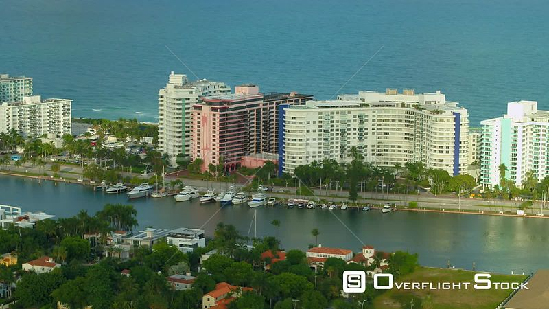 Yachts and Miami Beach Condominium buildings aerial stock drone footage