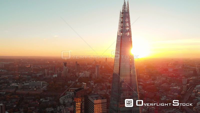The Shard and Tower Bridge, filmed by drone in autumn, at sunset, London, United Kingdom