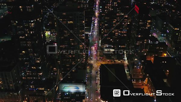 Toronto Ontario Flying path of nighttime street in birdseye to wide cityscape view