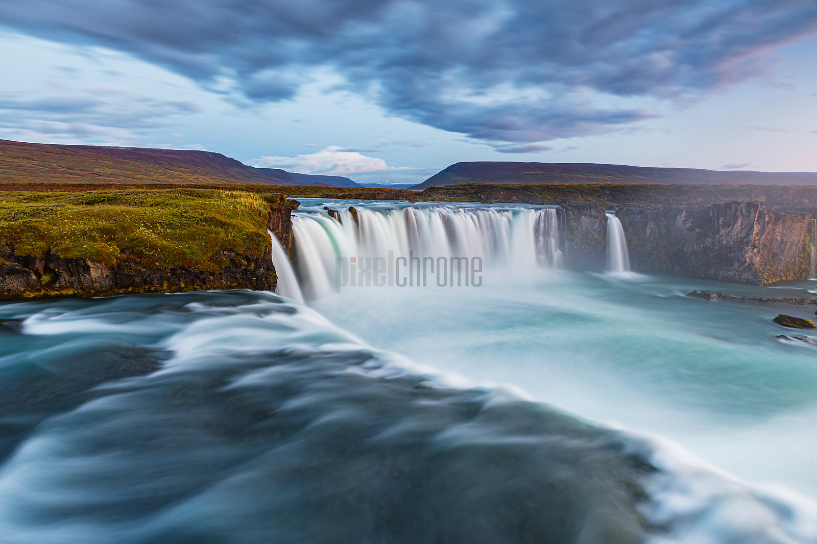 The Goðafoss waterfall is one of the most spectacular waterfalls in Iceland. The river Skjálfandafljót falls 12 meters over a...