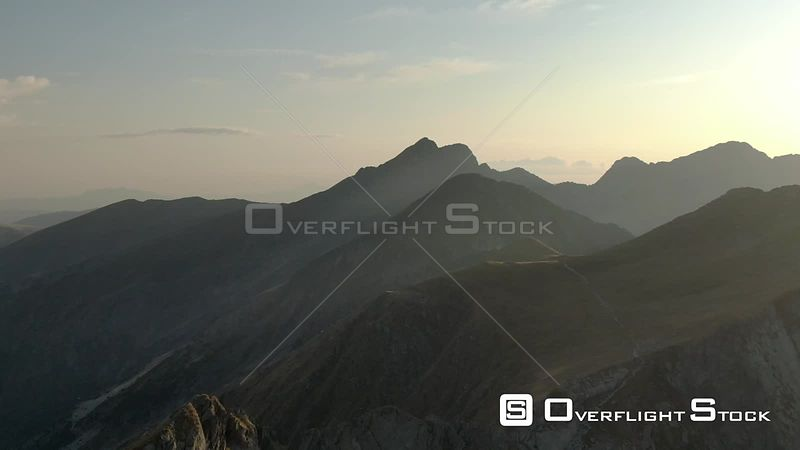 Mountain trail and mountain peaks at sunset. Romania