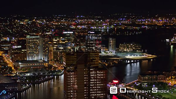 Baltimore Maryland Aerial Nighttime birdseye to panoramic cityscape view with building construction in foreground