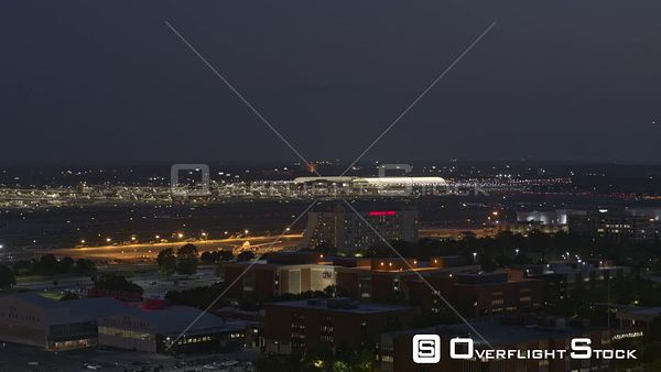 Atlanta Panoramic view of Delta airlines warehouse, hangars, terminals plus FedEx hangars at dusk night