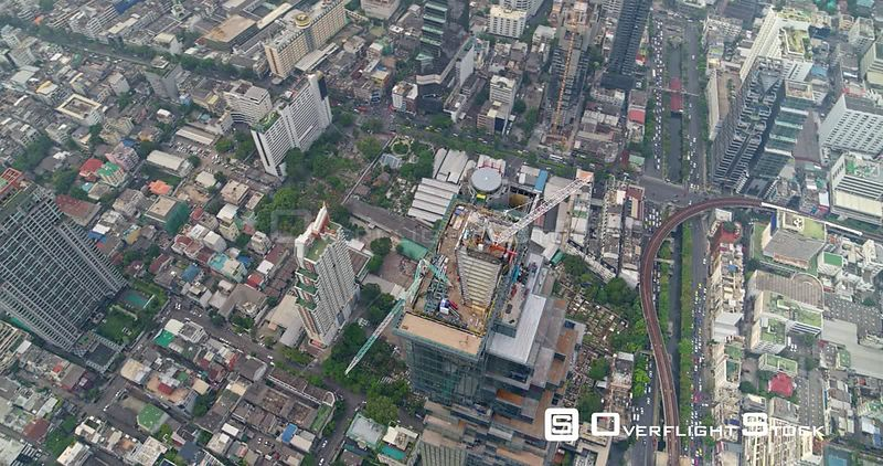 Thailand Bangkok Aerial Rotating vertical view of Bang Rak district with close up tower view