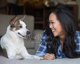 Cattle Dog and Young Asian Woman Smiling at Each Other