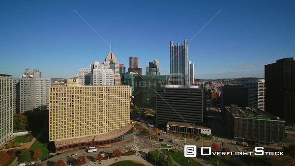 Pittsburgh Pennsylvania Downtown cityscape fly through from park to arena