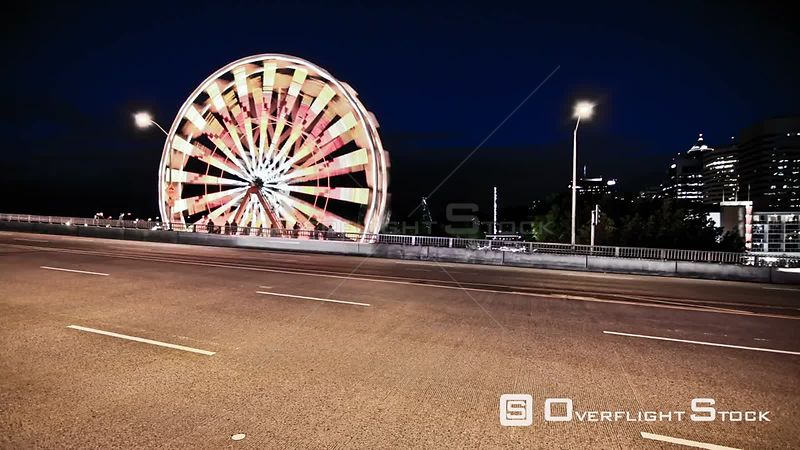 Time lapse clip of a ferris wheel and traffic passing by at night. Portland Oregon