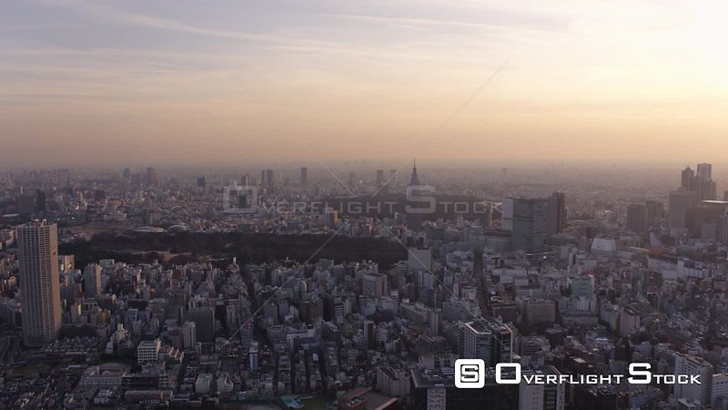 Japan Tokyo Aerial Flying over Shinjuku area panning cityscape views dusk