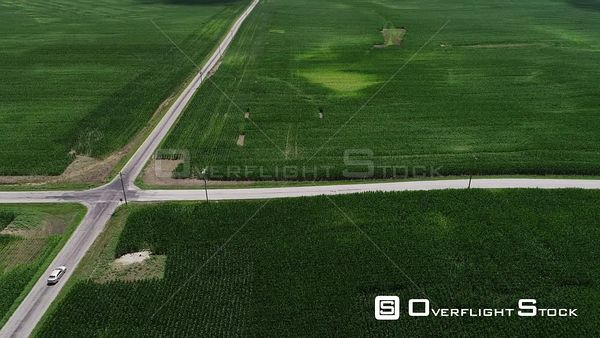 Tracking a Car on a Rural Road Corn Fields in Summer Indiana Drone Aerial View