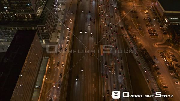 Atlanta Near vertical view following path of freeway to mid vantage view of downtown cityscape at night