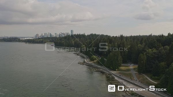 Vancouver BC Canada Descending toward park cityscape with people on seawall path