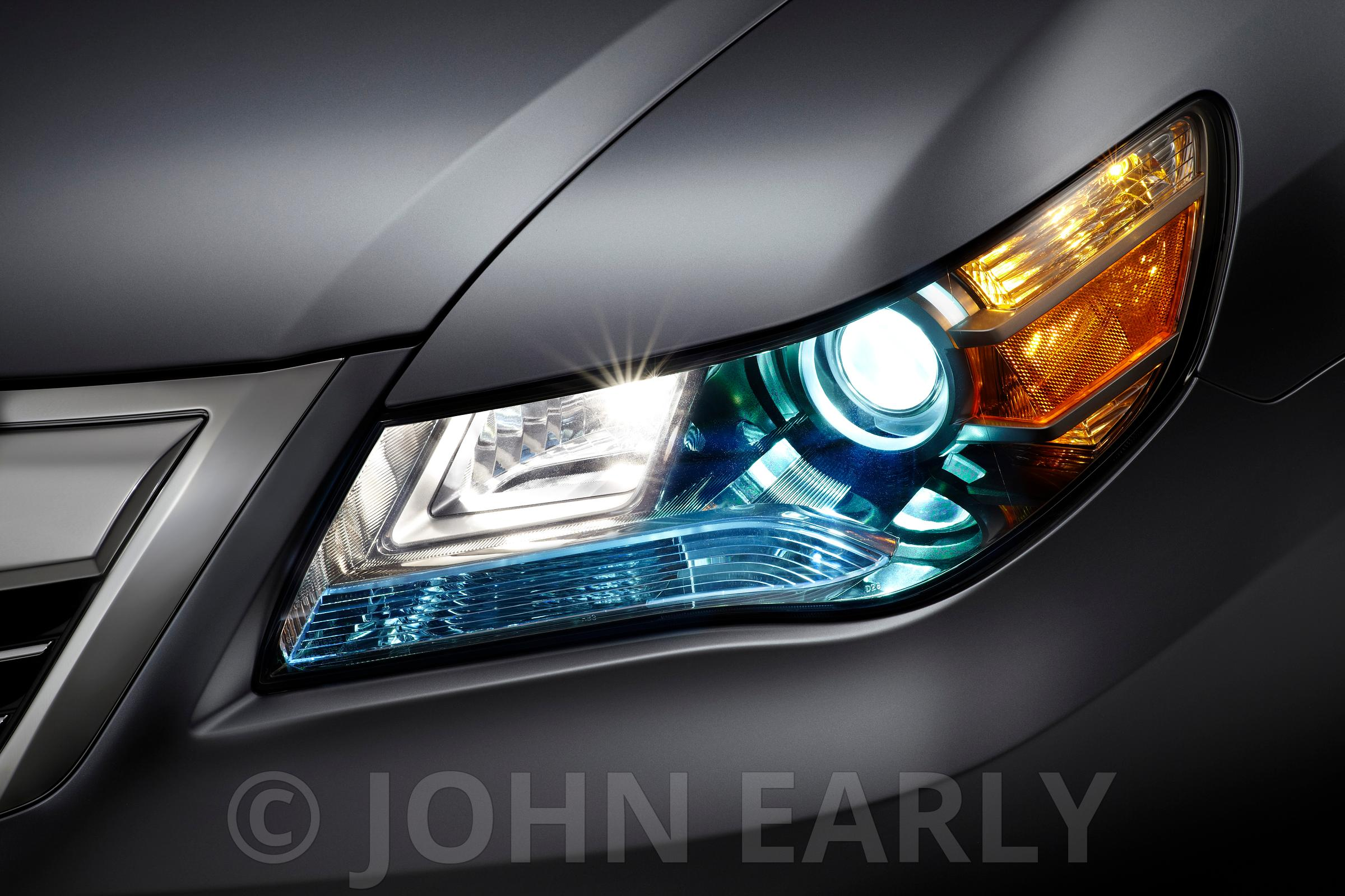 LED Headlight Close-up on Silver Vehicle