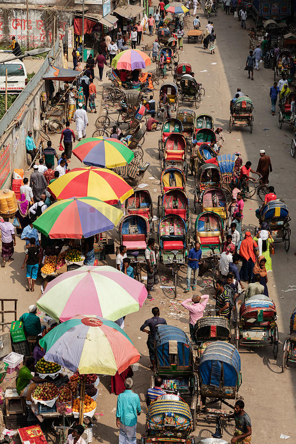 Rickshaws Parked next to the Babubazar Bridge