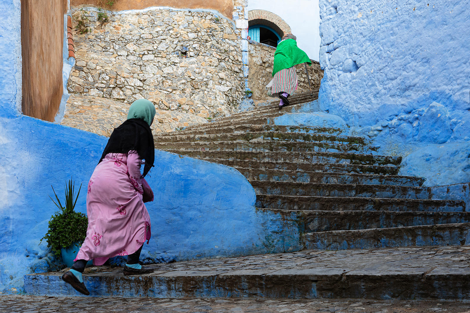 Women Walking up Steps in the Medina of Chefchaouen