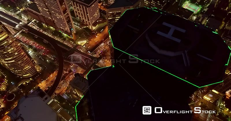 Thailand Bangkok Aerial Panning birdseye view of cityscape with tower close up at night