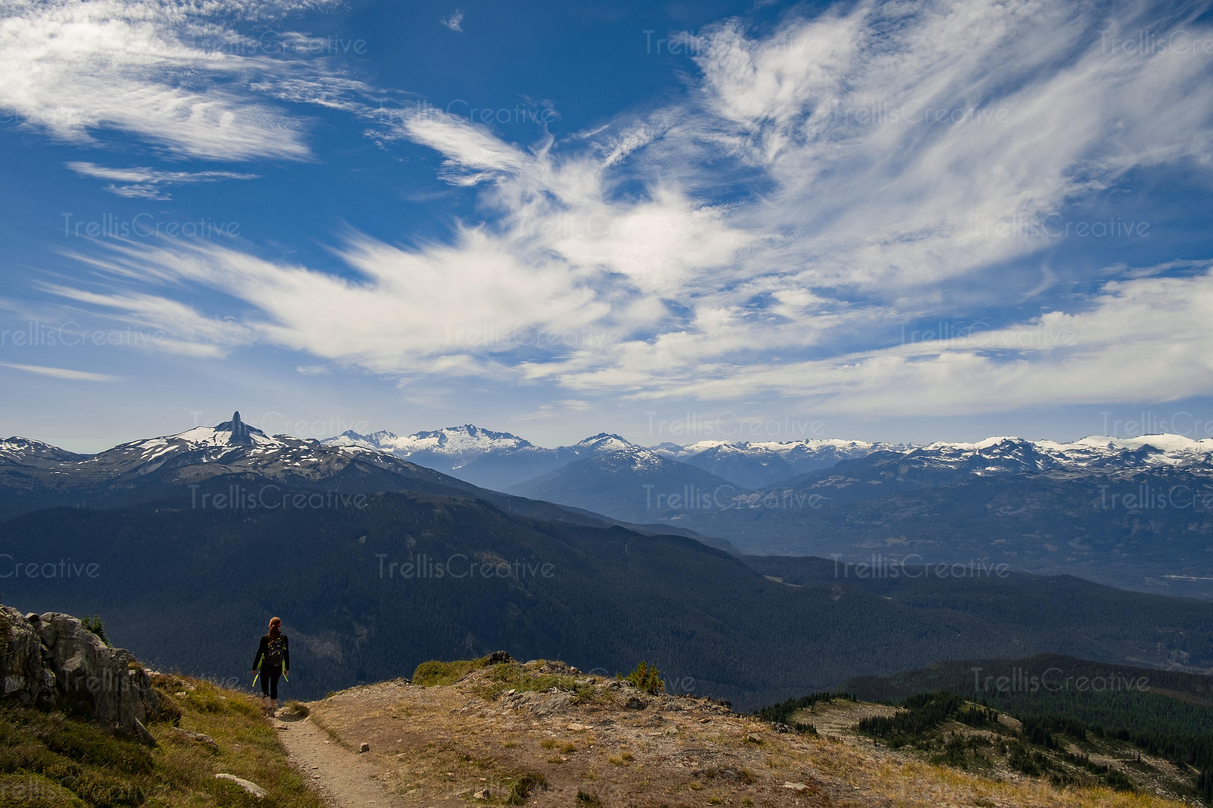 Female hiker at the top of a remote mountain trail, Blackcomb Mountain, Whistler, Canada.