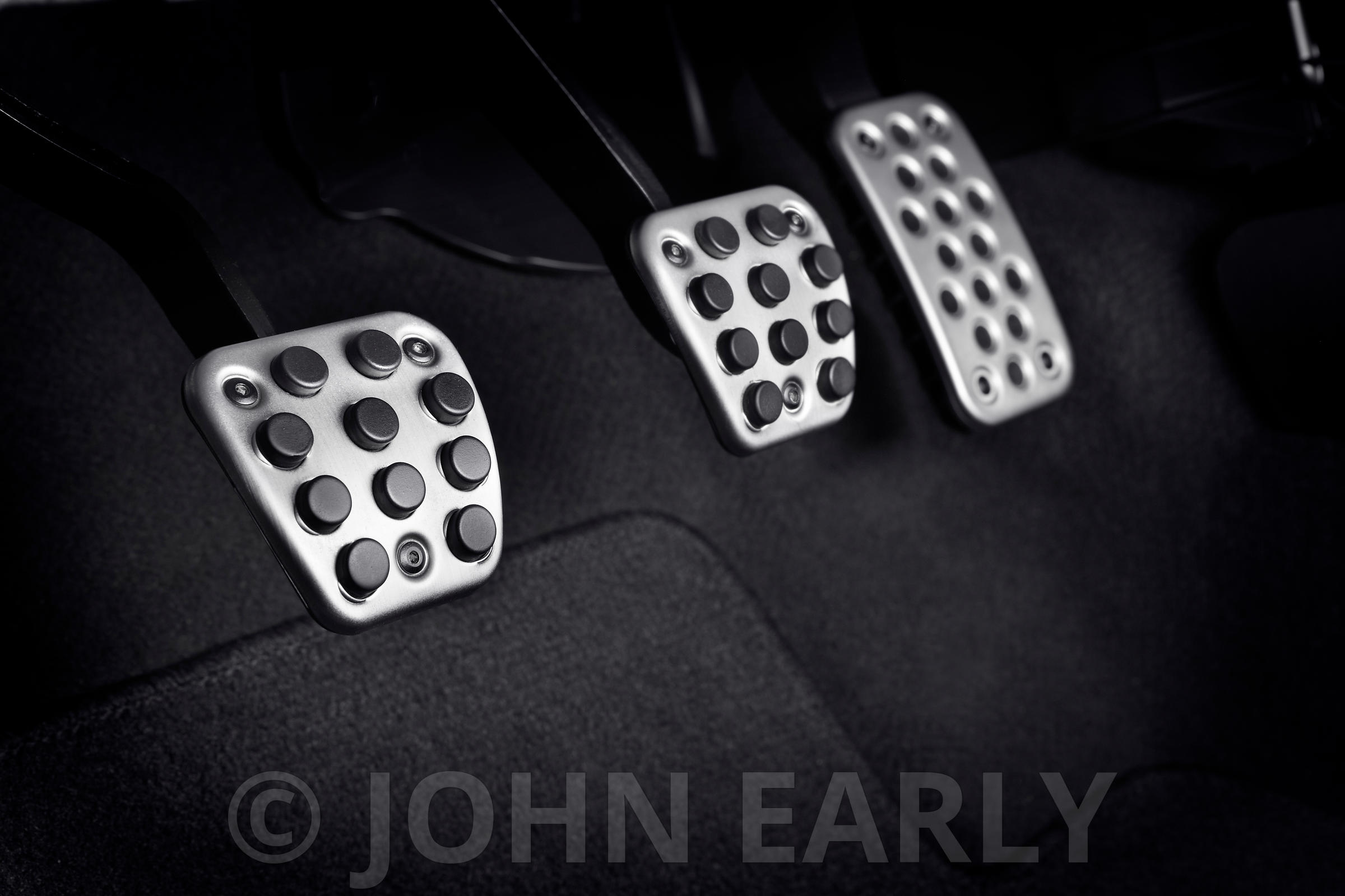 Detail View of Premium Metal Foot Pedals In A Car
