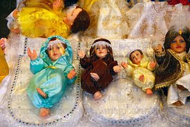 Baby Jesus figures (called Niños in Spanish) for nativity scenes wearing face masks and protective clothing against the covid...