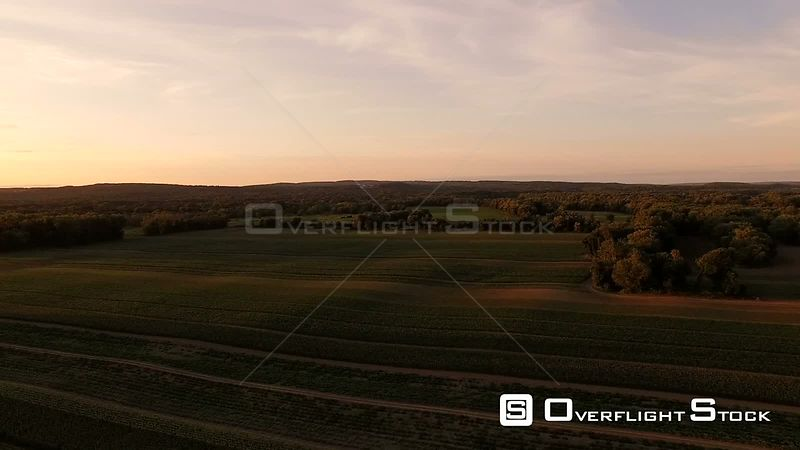 Flying low over farmland at sunrise. New Hampshire USA