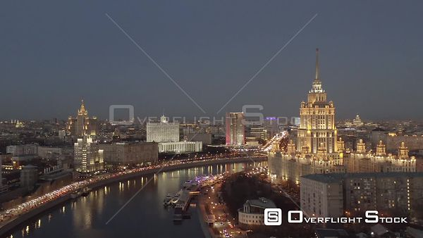 Dusk Sideways Flight Over the River With Moscow Center With Historical Buildings Lighten Up. Moscow Russia Drone Video View
