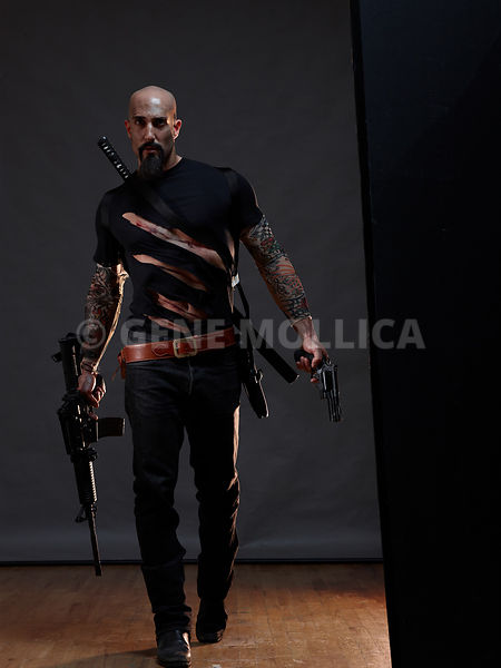 Bald Male with Multi Guns