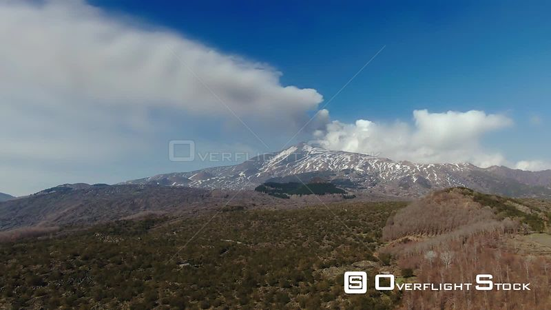 Aerial dolly view of mount Etna in winter, the biggest volcano in Europe. Italy