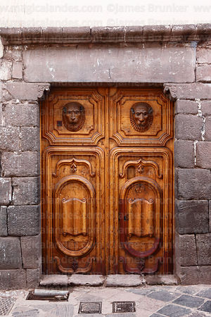 Carved wooden colonial door with lion heads, Cusco, Peru