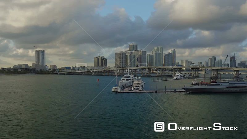 Miami Florida Flying over main channel panning with luxury yachts views.