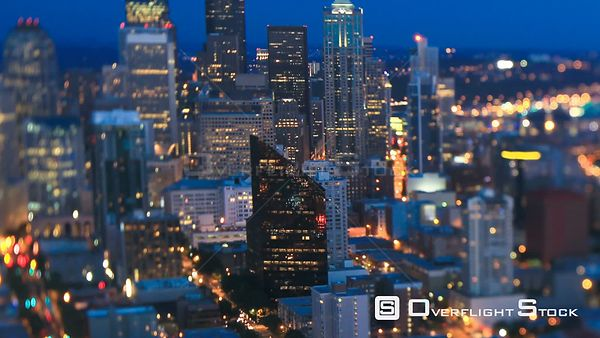 Seattle Washington State USA Panning Seattle cityscape time lapse at dusk using a tilt shift lens with skyscrapers in focus a...