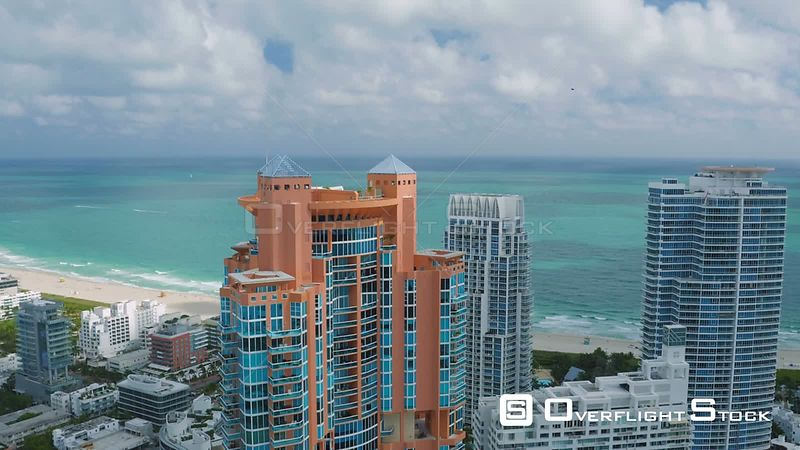 Miami Florida Flying over South Beach panning down over tall condo buildings.