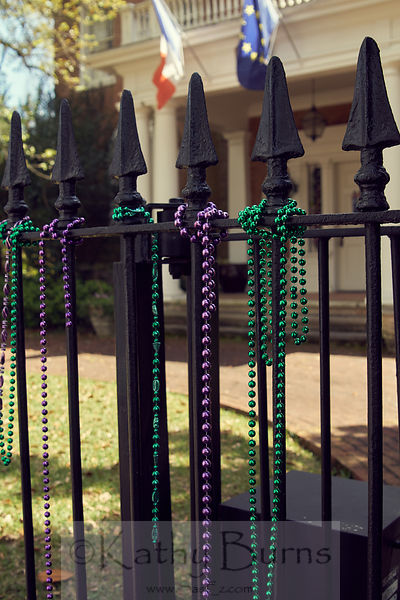 New Orleans beads on a fence
