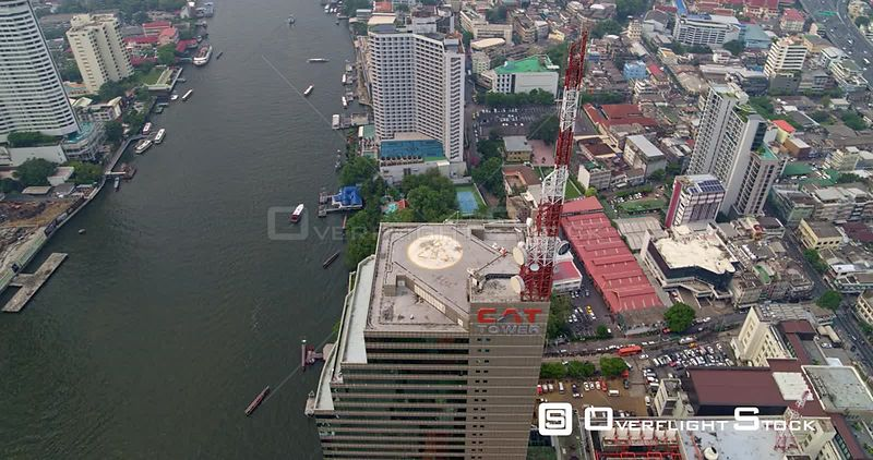 Thailand Bangkok Aerial Detail of helipad to cityscape & river panning view