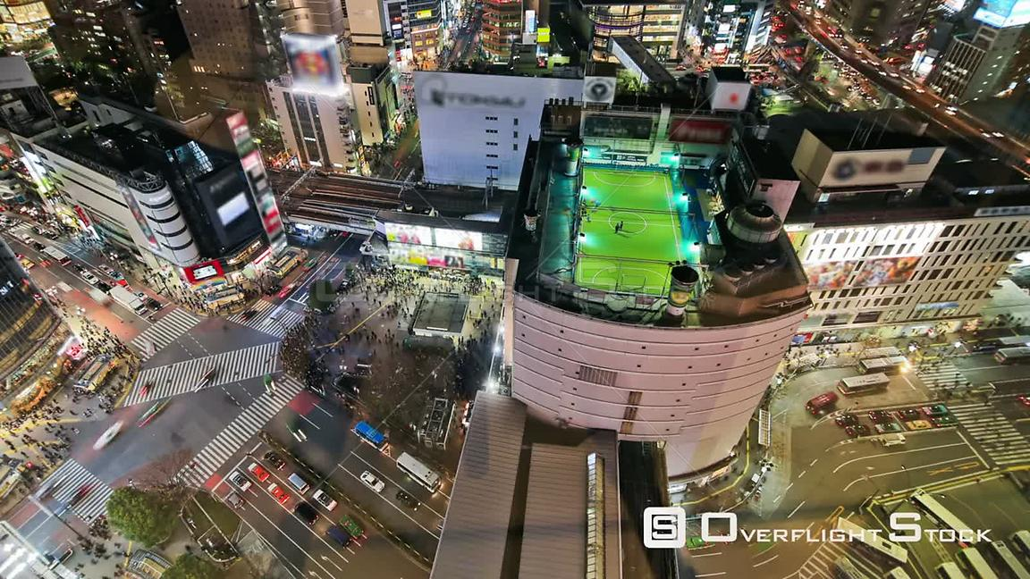 Aerial city traffic time lapse of busy Tokyo intersection downtown at night. Japan